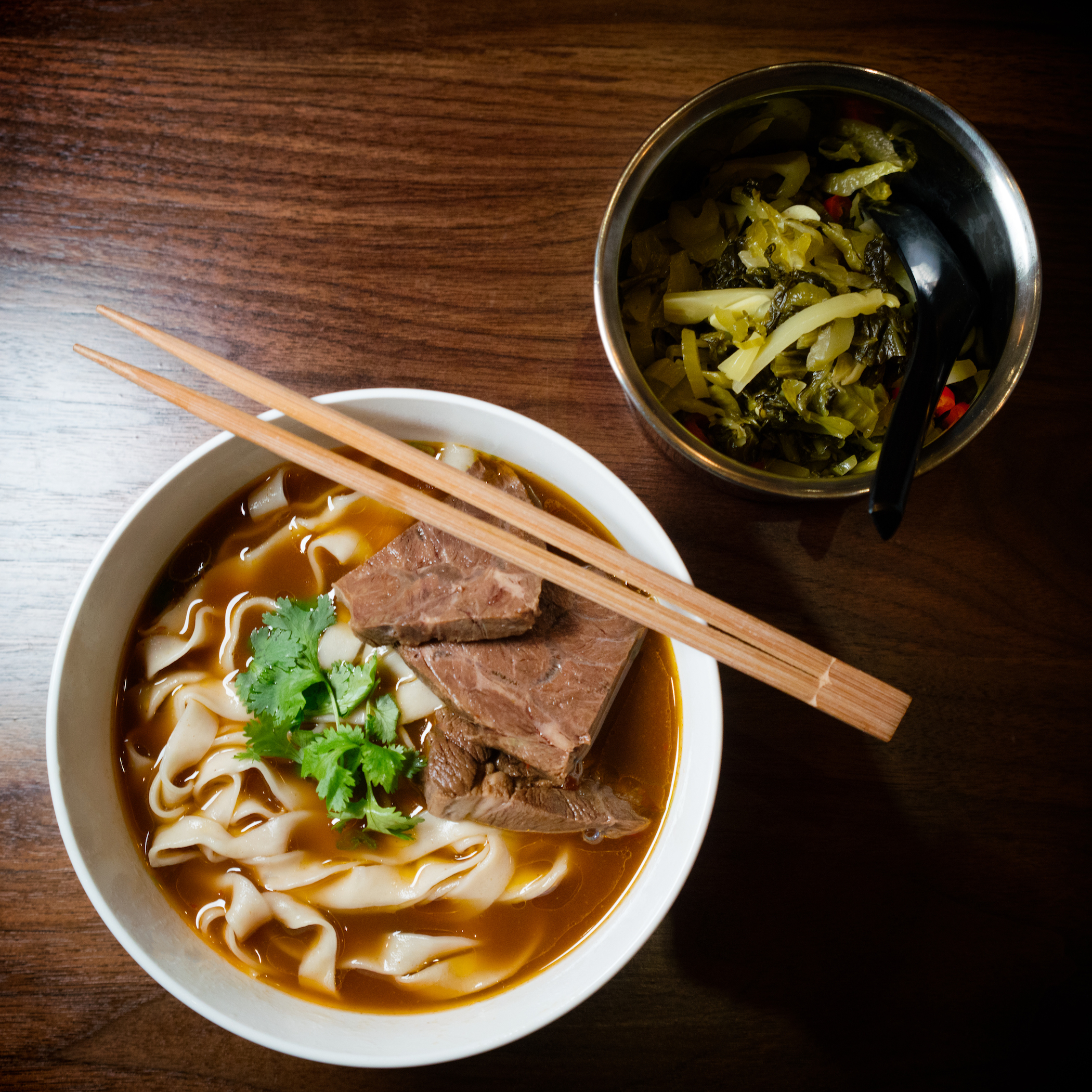 ho foods beef noodle soup and mustard greens